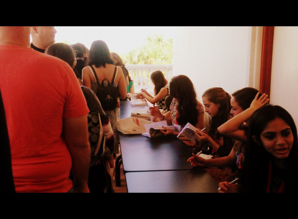 Waiting in line to get my book signed by all...forty writers!